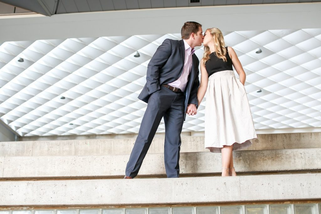 bride and groom kissing during engagement photoshoot