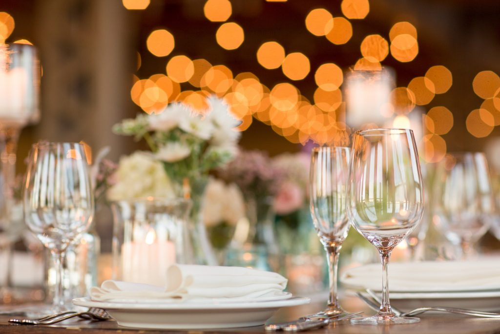 bokeh photograph of a beautifully decorated table top with empty wine glasses