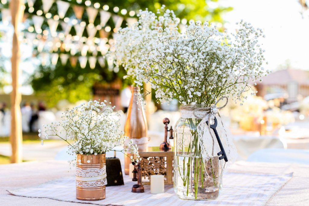 bunch of baby's breath flowers in a mason jar table decor