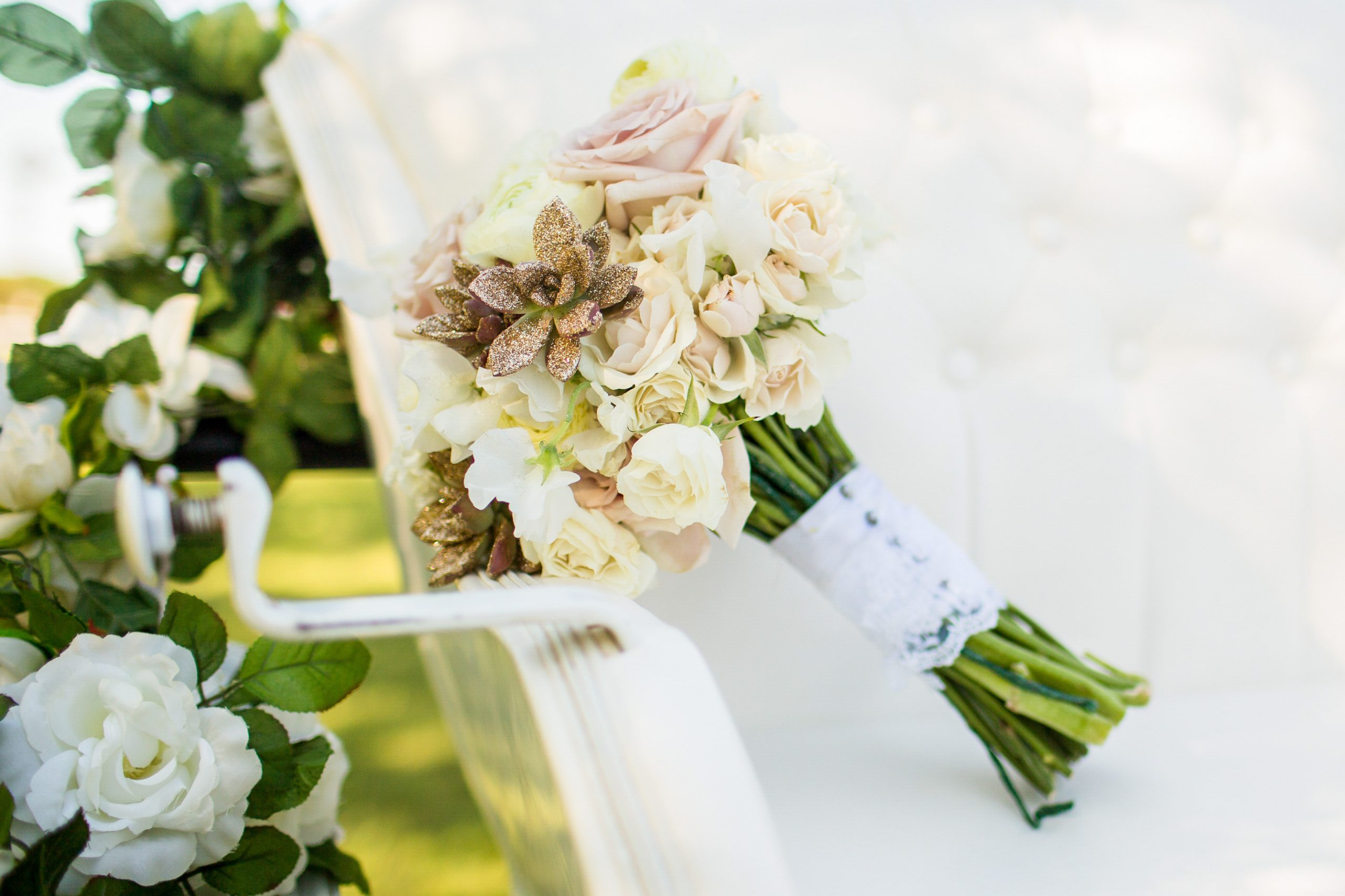 a beautiful bouquet of white roses and succulents