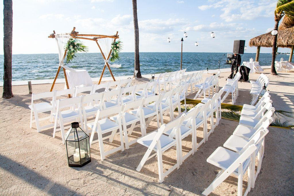A beautifully decorated altar in an outdoor beach themed wedding ceremony