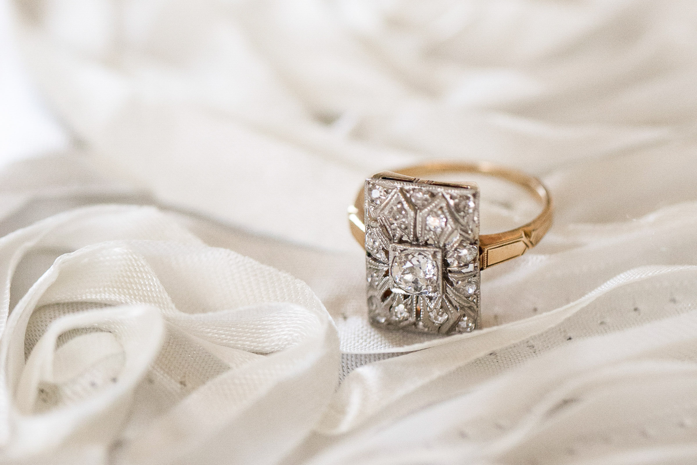 a beautiful engagement ring studded with diamonds