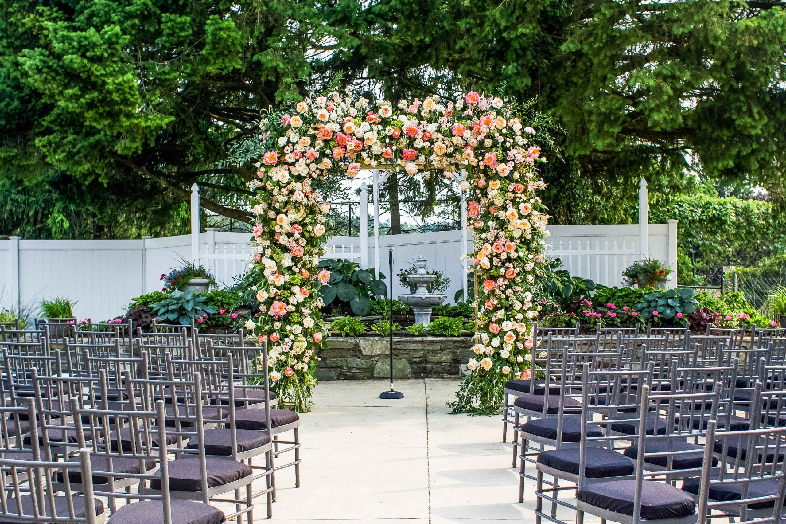 A ceremony aisle decorated beautifully with multicolored flowers